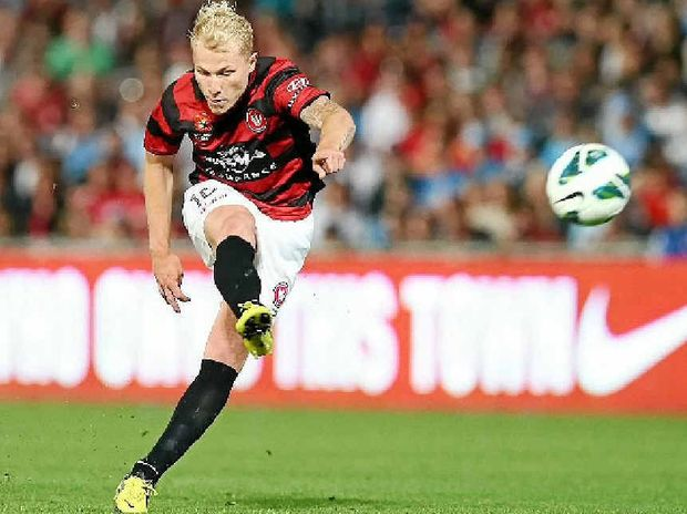 PLAYMAKER: Wanderers midfielder Aaron Mooy takes a shot at goal in last Saturday night's Sydney derby.