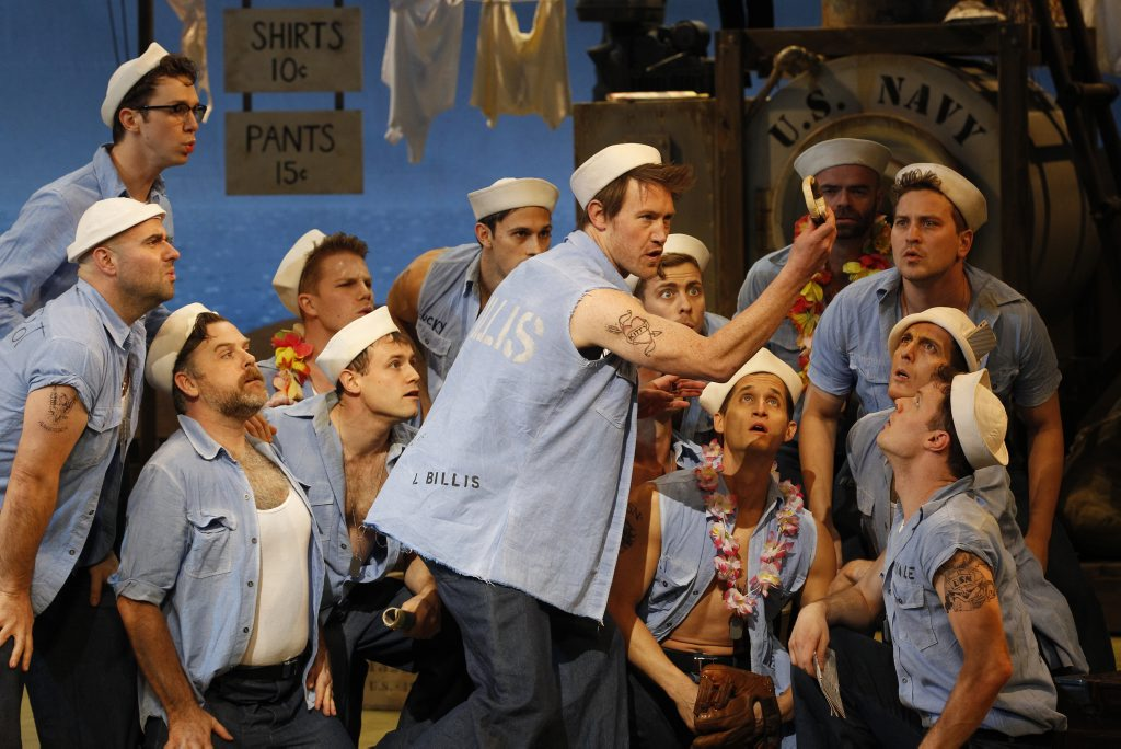 Eddie Perfect (centre) in a scene from the musical South Pacific.