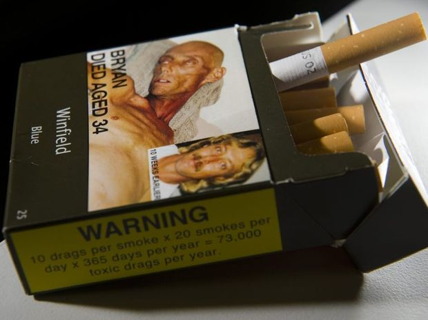 A packet of cigarettes showing the new plain package and health warnings.
