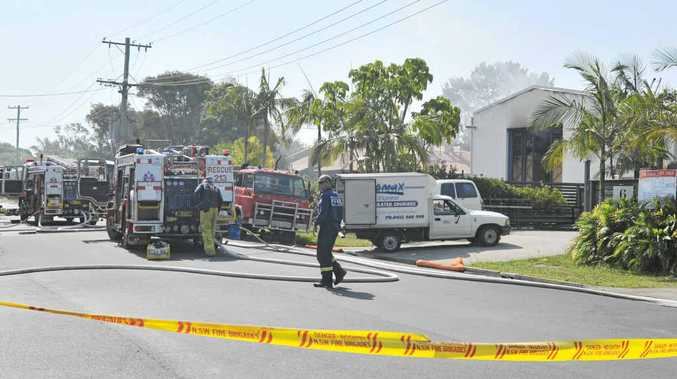 SMOKE THREAT: Firefighters battle yesterday's blaze in Centennial Ct in the industrial estate at Byron Bay.
