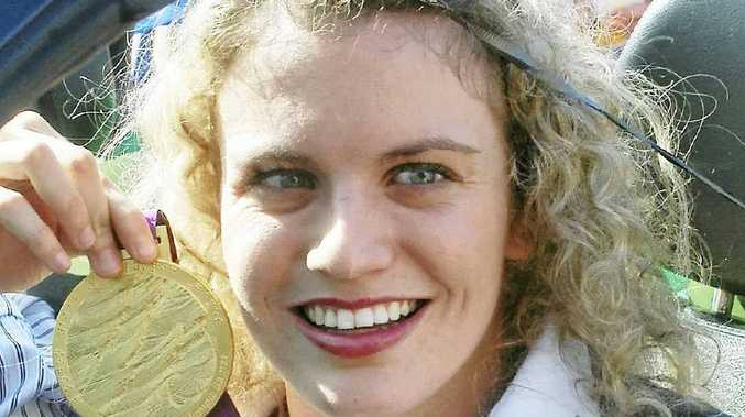 Jacqueline Freney with one of the eight gold medals she won at the London Paralympics.
