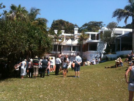 Close to 100 people attended this afternoon's auction on site in Byron Bay as the iconic resort went under the hammer.