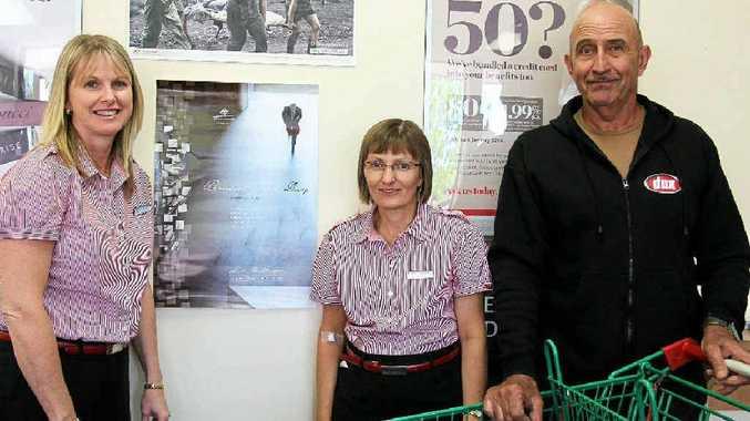 Westpac's Jen Beattie and Regina Henry with former solider Johno Felton.
