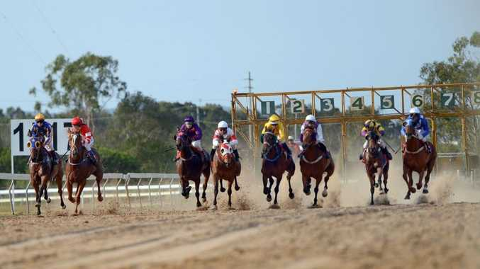 The field thunders down the straight at the start of the Class B handicap at Ferguson Park.