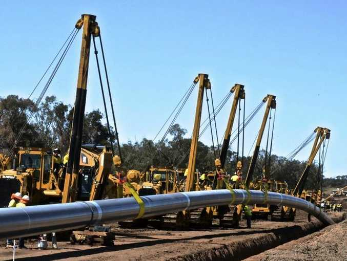 Australia Pacific LNG's main transmission pipeline going into the ground.