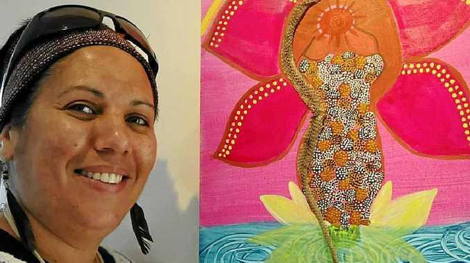 LETTING GO: Malinda Flynn with her work Shedding Skin exhibited as part of Through Our Dark Eyes at Jambana Aboriginal Art Gallery in Casino.