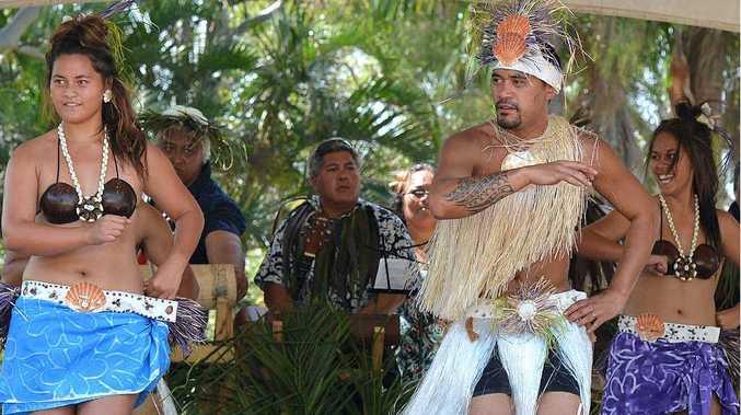 Kia Okotai Performing Arts and Culture's Ruta Tui, Jason Daniel and Tafai Billy perform in handmade costumes.