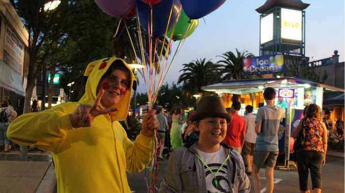 Clayton and Morgan Vellacott were happy to lend a hand at the Mardi Gras on Friday night.
