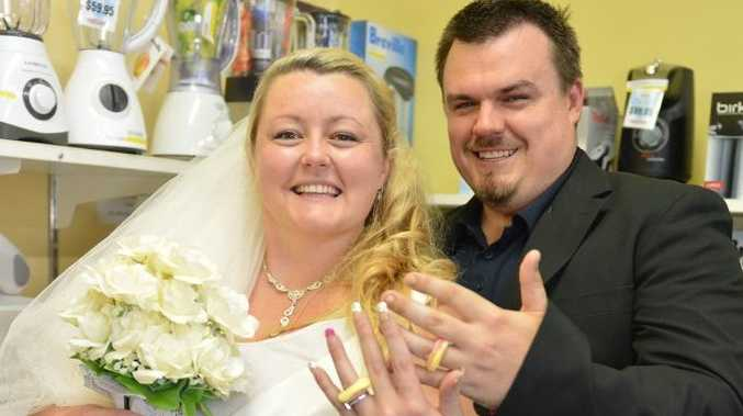 Amanda Howard threw her fiance Drew Sadler a surprise mock wedding at Webbers Retravision, Mackay on Wood Street. They even had 'jelly' type rings.l Photo Lee Constable / Daily Mercury
