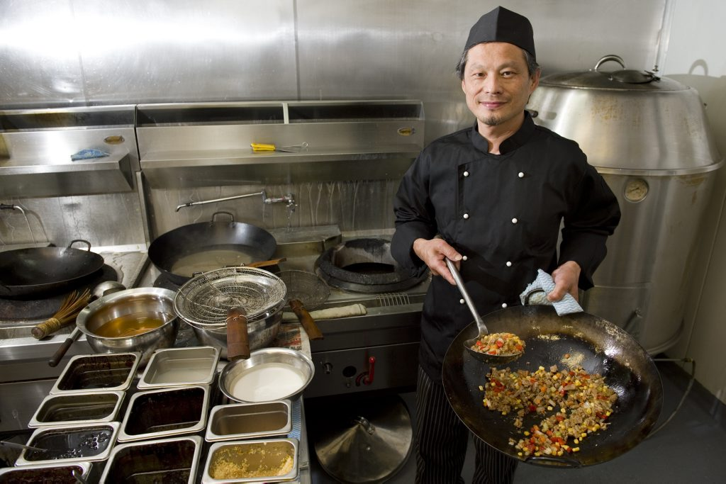Stanley Poon works in the kitchen of Qi'Lin Oriental Cuisine. The restaurant has been awarded Australia's best chinese restaurant in the 2012 Savour Australia Restaurant and Catering Awards, Tuesday, October 30, 2012. Photo Kevin Farmer / The Chronicle