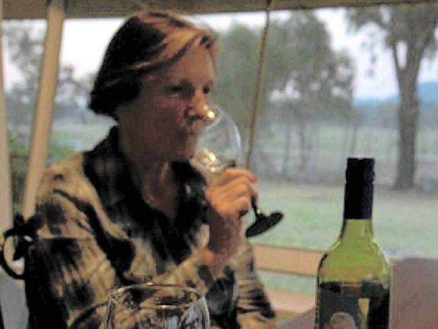 WINE TIME: Margot Tesch at home after a long day's work.