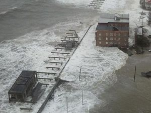 QBE cuts profit forecast after Hurricane Sandy