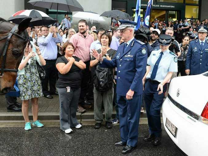Outgoing Queensland Police Commissioner Bob Atkinson is farewelled during a 'Piping Out' Ceremony at the Queensland Police Headquarters in Brisbane. (AAP Image/Dave Hunt)