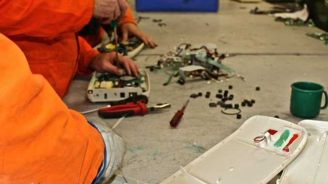 Prisoners salvage parts from e-waste.