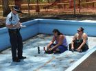 Mum of 6 arrested over pool demolition protest