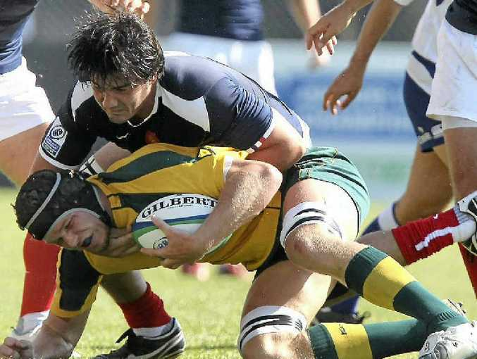 Playing for Australia, Blake Enever gets tackled by France's Mathias Marie during the IRB Junior World Championship playoff match for third between France and Australia in Italy last year.