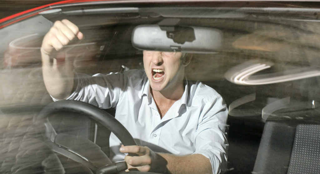 A frustrated commuter loses his cool in the car.