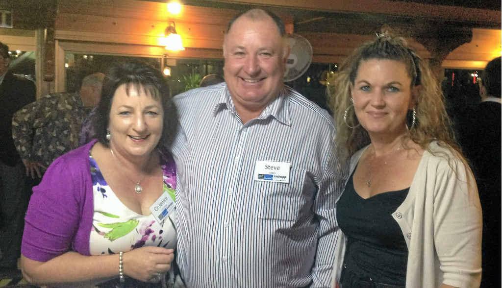 Councillor Janie Holstein celebrates Withcott's Tidy Town win with Mayor Steve Jones and Deputy Mayor Tanya Milligan.