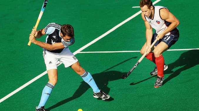 NEXT MOVE: Ipswich-bred Australia A hockey player Tim Bates (right) is hoping to re-establish his place in the Kookaburras squad.