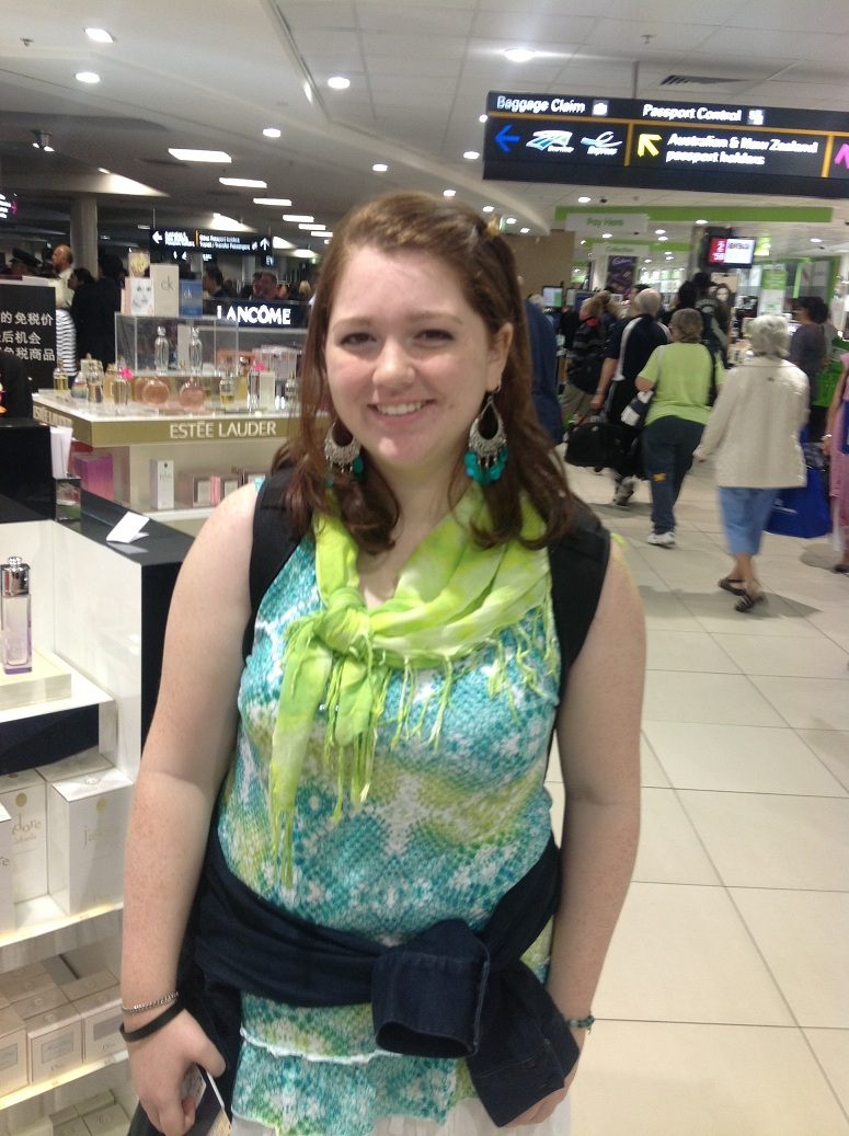Emily, pictured at LAX, heading to Brisbane to be with her fiancee and worrying about family on the US East Coast