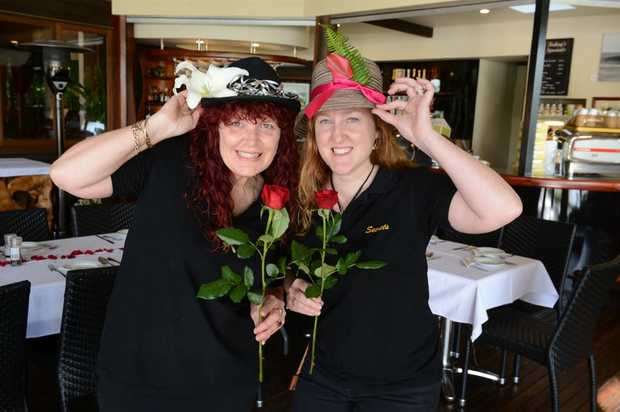 Julie Roser and Debbie Blackley get ready for the Melbourne Cup Luncheon at Secrets on the Lake.