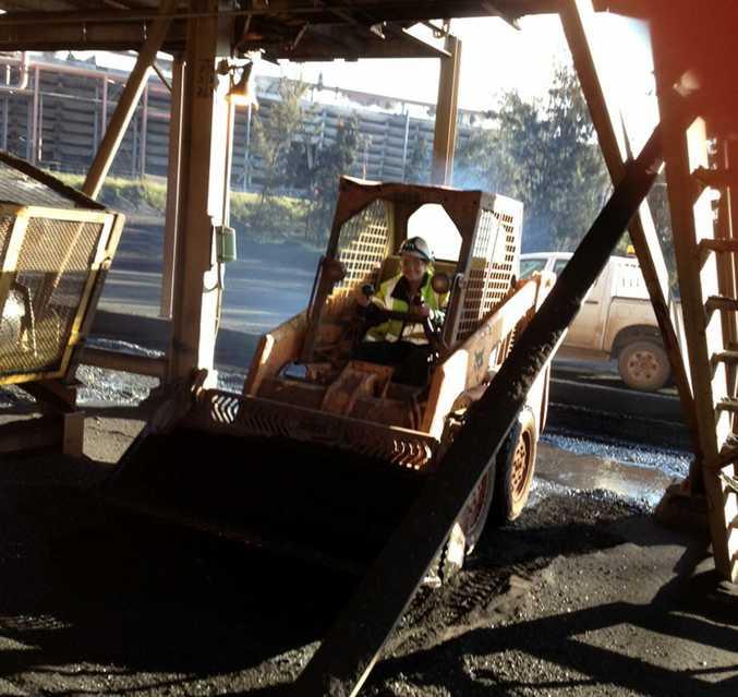 Fashion poll winner Ashley Mitchell drives a bobcat at QAL.