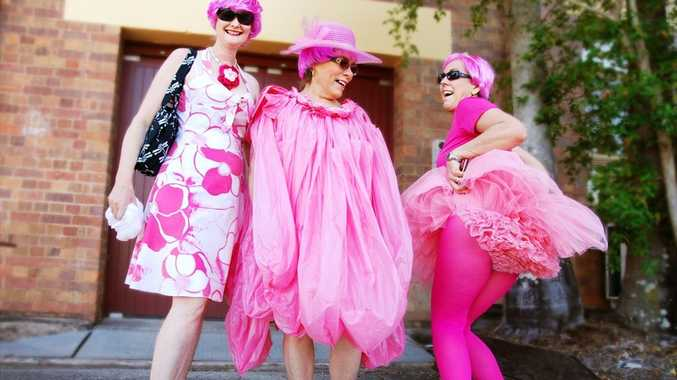 Local business owner and prize winner Margaret Kippen (centre) and friends in front of the Butter Factory Arts Centre in their pink costumes.