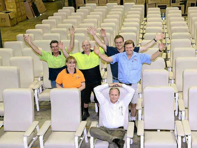BizFurn has designed and made over 200 lounges for the Gold Coast Hospital. Celebrating are Ron McLaren, Tony Shaw, Des Knowles, Shane Smith, Jackie Turgood and (front) Erick Buma.
