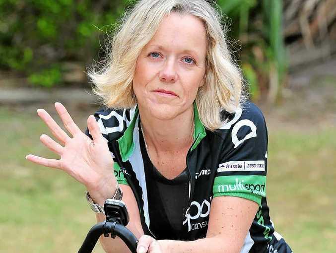 BACK ON HER BIKE: Julie Moore shows off her shortened digit.
