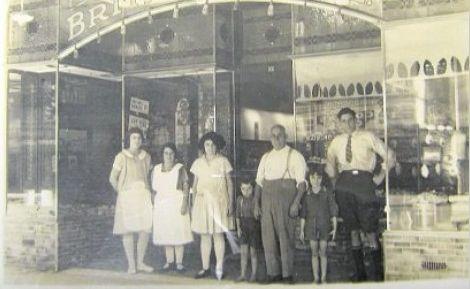 (From left) Staff member, Haley Malanos (nee Comino), Matina Notaras (nee Comino), Cyril Comino, Peter Comino, Eftihia Likidis (nee Comino) and Jim Comino.