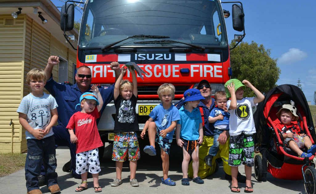Yamba Playgroup members with Yamba Fire Station's Deputy Captain Dave Woods and firefighter Mick Brooks.