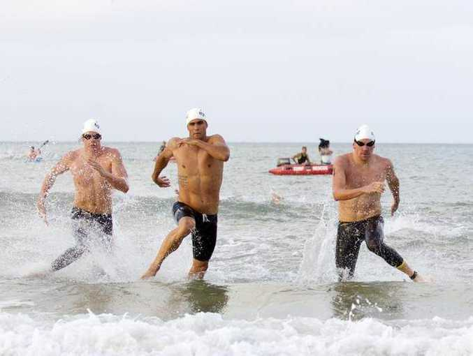 Ridge Grimsey, Ky Hurst and Trent Grimse battle it out in the Noosa ocean swim. Photo: Eyes Wide Open Images