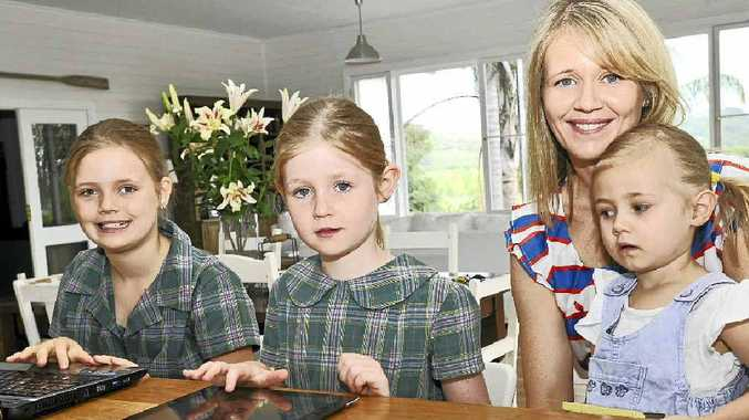 COMPUTER SAVVY: Jane Thomson with her daughters (from left) Eloise Payne, 9, Sabrina Payne, 7 and Josephine Payne, 2. Ms Thomson has strict limits on the amount of screen time her daughters have each day.