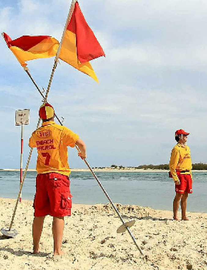 PLAYING IT SAFE: Caloundra City lifesavers close the beach yesterday.