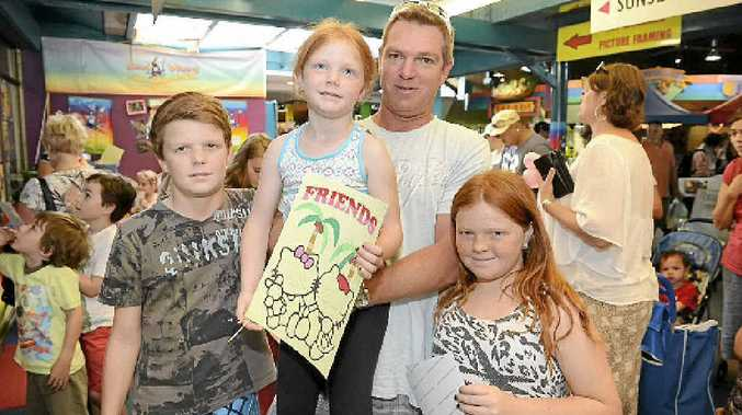 WELCOME RETURN: Tim Merton with his children Taylen, Layla (in his arms) and Emma.