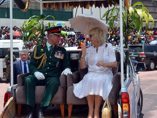 Prince Charles and Camilla on the back of a ute in PNG. It's a fair bet they won't arrive in similar style at the Melbourne Cup.