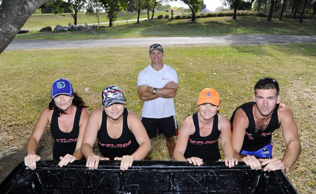 Warrior Dash participants Mary Squires, Keiran Shanley, Renee Fahey and Alex Jefferies under the watchful eye of trainer Craig Nipperess (back) at Corcoran Park.