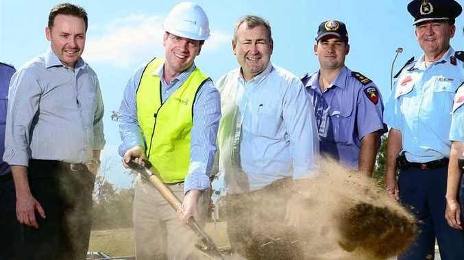 PROJECT UNDER WAY: Constructions Group site manager Iain Harris, with Police and Community Safety Minister Jack Dempsey and Member for Ipswich West Sean Choat turn the first sod at the site of the new Brassall Fire Station.