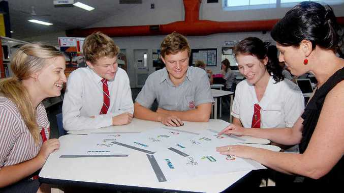 Whitsunday Anglican students Rachael Treacy, Connor Herron, Jimmy Van Den Heever and Alanna Begley talk with Claire Christensen about the new smart phone app that will save them money.