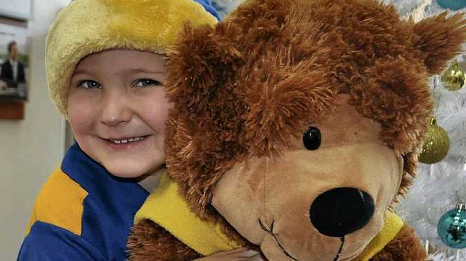 Help disadvantaged kids wake up to a present this Christmas. Henry McMillan shows just how much a teddy and book can mean on Christmas morning.