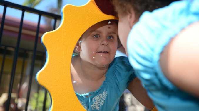 Keira Hughes, 8, explores the Rosella Park School's Pixie Park sensory garden.