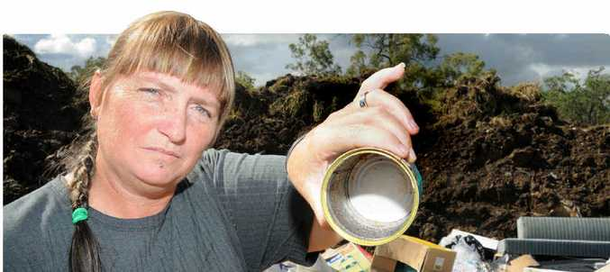 TAKE MORE CARE: Wildlife carer Sandra Moye picks up a problem can at Kilkivan dump and her photo (right) of a feral cat before it was rescued.