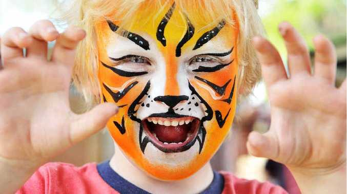 GRRRRR: Jack Trevorrow gets in character at the Ipswich Kindergarten Milford St fete on Saturday.