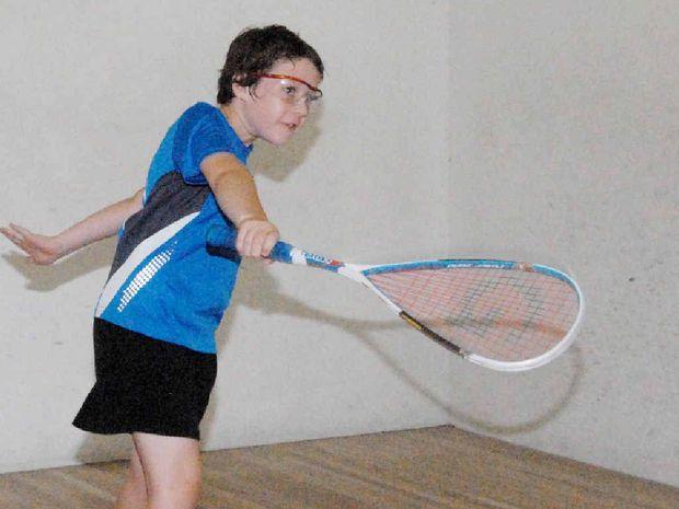 Alex Fox follows through with a backhand during the Mackay Open squash tournament.
