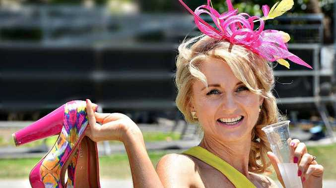 Fiona McNeilly steps out in style yesterday to enjoy Melbourne Cup Day celebrations at Ooralea Racecourse.