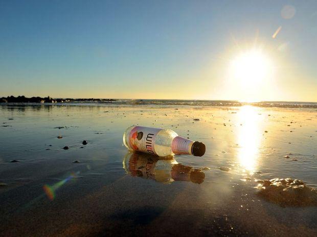 Empty bottle on Bargara Beach. Photo: Max Fleet / NewsMail