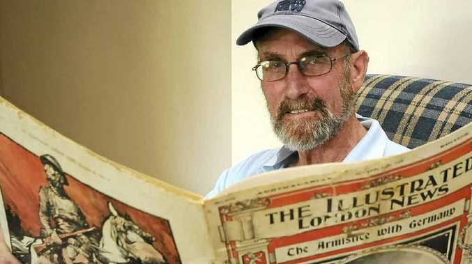 OLD NEWS: Ballina's John Leckenby with the original November 16, 1918, Australasian edition of The Illustrated London News which was found under lino.