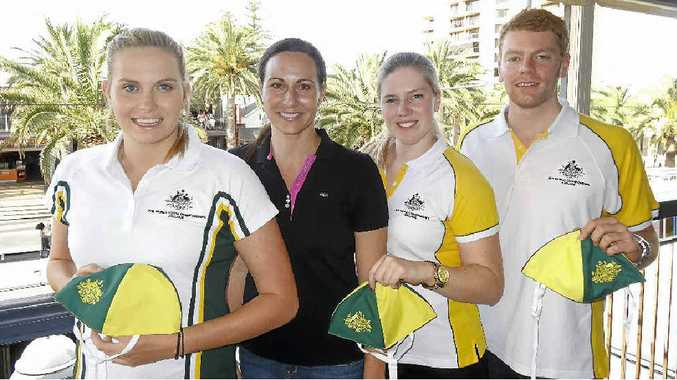 READY TO GO: Australian team members Alisha Ellwood (under-20s), Pamela Hendry and Sam Bell (open) with former Australian captain Kristy Munroe, who presented the caps at a special function in Glenelg.