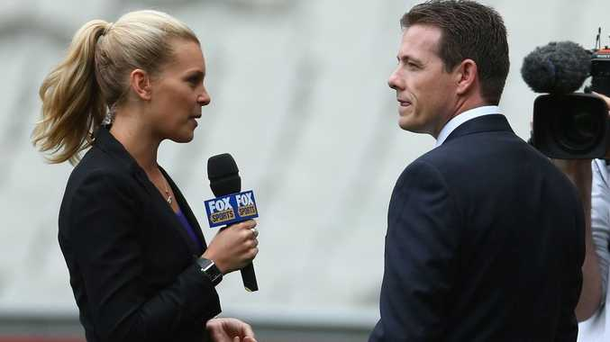 Lachlan Stevens (right) being interviewed.