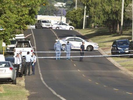 Police cordon off Hogg St, Rockville, the scene of yesterday's murder.